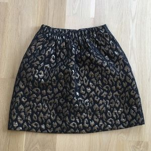 Metallic gold and black Kenneth Cole mini skirt